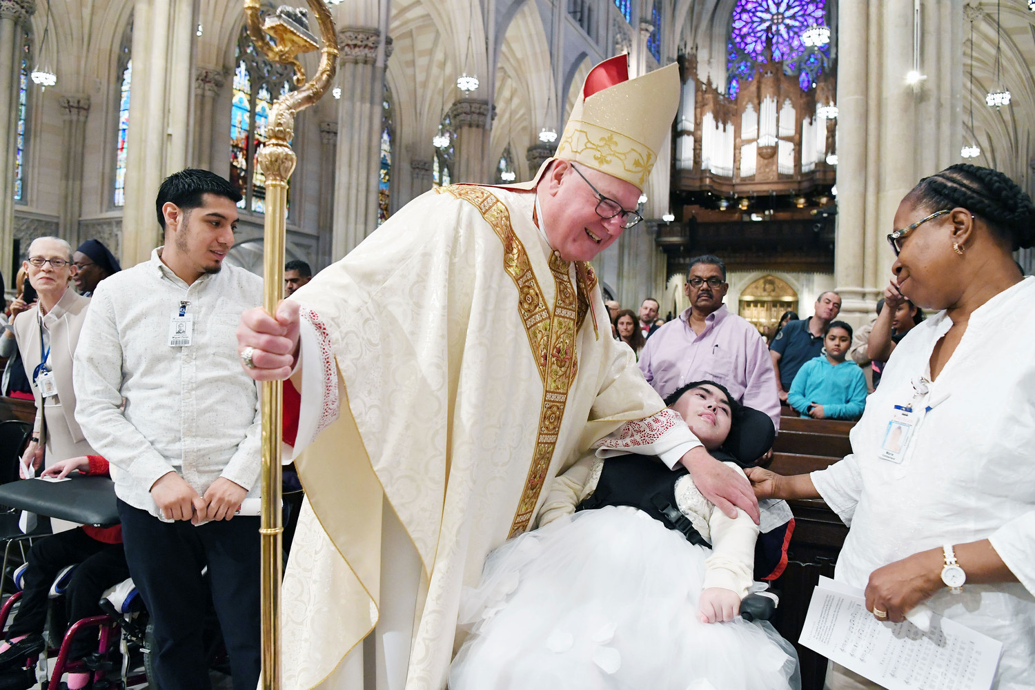 cardinal dolan with patient