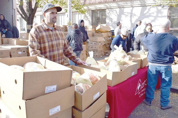 Man giving away turkeys