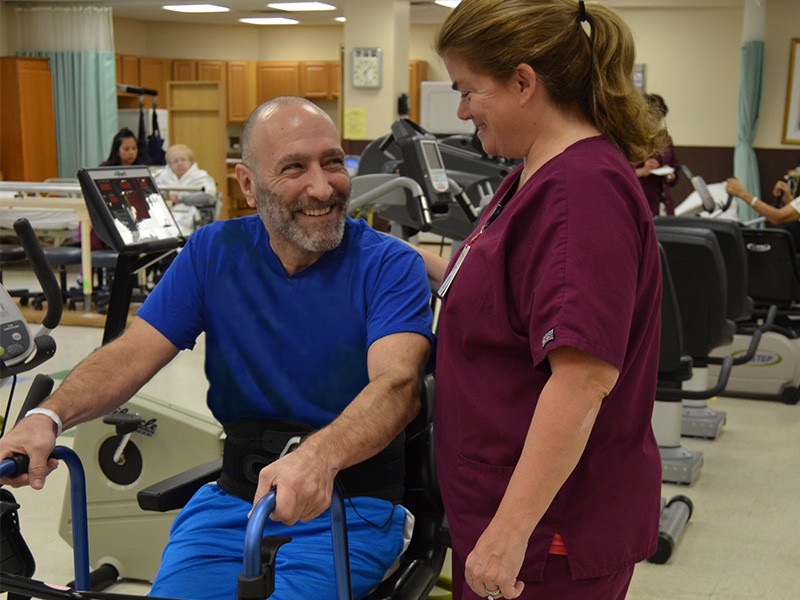 ArchCare nurse helping man exercise