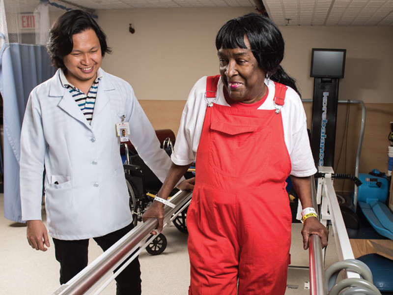 ArchCare at Terence Cardinal Cooke Health Care Center rehab specialist working with a senior patient