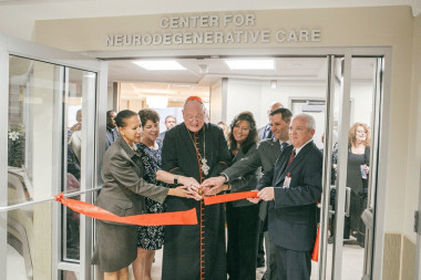 Archbishop Cardinal Timothy Dolan blessing the center for neurodegenerative care
