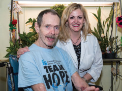 ArchCare at Terence Cardinal Cooke Health Care Center Huntington's disease patient smiling with a nurse