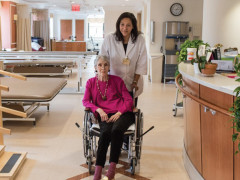 Mary Manning Walsh nurse pushing a senior in a wheel chair