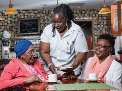 ArchCare at Mary Manning Walsh Home staff speaking with seniors